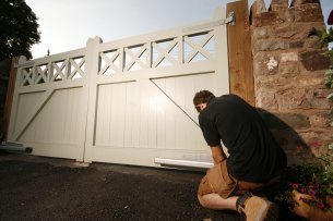Fitting a wooden open flat top electric driveway gate