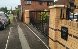 steel sliding straight top metal gates with finials street view