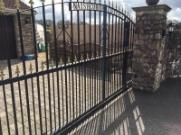 automated steel swinging arch top metal gates with finials and dog bars