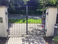 automated steel swinging arch top metal gates bristol view onto street