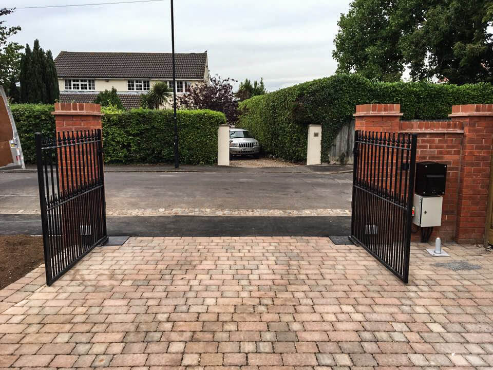steel swinging straight top metal driveway gates with finials and dog rails