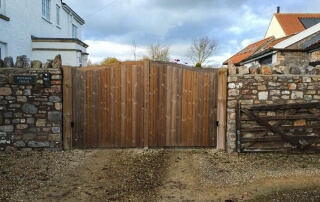 Automated Wooden bell top driveway gate by Elex Automation