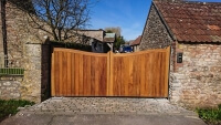 Automated Wooden bow top driveway gate by Elex Automation