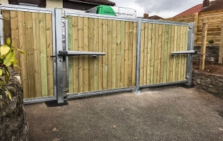 swinging flat top domestic automated wood fill galvanised metal framed gate