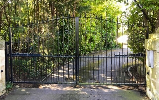 automated steel swinging bell top metal gates with finials and dog bars bristol