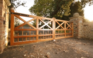 automated traditional wooden five bar driveway gate